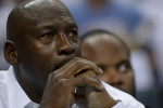 CHARLOTTE, NC - APRIL 26:  Michael Jordan watches as the Charlotte Bobcats play the Miami Heat in Game Three of the Eastern Conference Quarterfinals during the 2014 NBA Playoffs at Time Warner Cable Arena on April 26, 2014 in Charlotte, North Carolina. NOTE TO USER: User expressly acknowledges and agrees that, by downloading and or using this photograph, User is consenting to the terms and conditions of the Getty Images License Agreement.  (Photo by Grant Halverson/Getty Images)